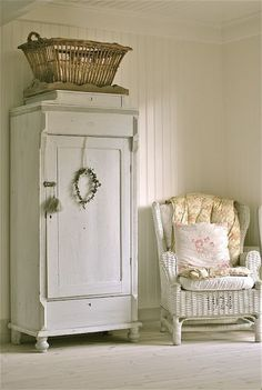 Old cabinet with wreath.