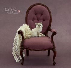 """Bitty Blue Eyes"" is a dollhouse miniature mitted lynx-point kitten sculpture of polymer clay & cashmere/alpaca fibers."