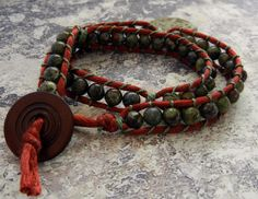 """This is a nice variation of the wrapped bracelet- making """"links"""" every so often by wrapping the thread around the cord a few times before continuing with the beads."""