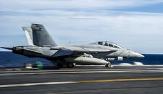 SOUTH CHINA SEA (July 1, 2014) An F/A-18F Super Hornet from the Diamondbacks of Strike Fighter Squadron (VFA) 102, launches from the aircraft carrier USS George Washington (CVN 73). George Washington and its embarked air wing, Carrier Air Wing (CVW) 5, provide a combat-ready force that protects and defends the collective maritime interest of the U.S. and its allies and partners in the Indo-Asia-Pacific region. (U.S. Navy photo by Mass Communication Specialist 3rd Chris Cavagnaro/Released)