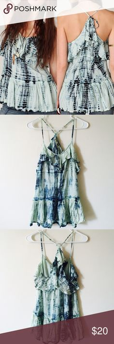 Free People Tie Dye Racerback Top +Brand: Free People  +Listed Size: Medium  +Color: Shades of blue, yellow. +Materials: 100% rayon +Features: adjustable straps fits many sizes! :)   -Flaws: None. {I do not trade.} {Please use the offer button for negotiating.} {Bundles = Discounts!!} Free People Tops Tank Tops