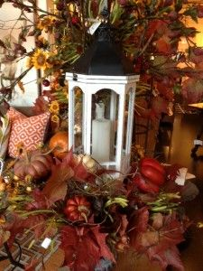 Fall foliage and a candle in the lantern.