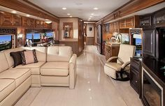 The inside of a luxury RV.  Okay ladies were going Camping I'll be there to pick You all up This will be the first time you hear me say that It's nice is a home