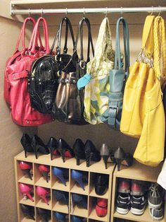 shower curtain hooks as purse holders... Genius! I like! Could use a tension rod to hang hooks from, too!