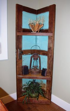 Old door turned to bookshelf- I could see this for the dining room, I love how the color highlights what's displayed