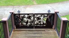 Custom southern style #gate with palm trees, wolf, and a crow's nest (Crow's Nest is the name of this log home!).  We can design anything to fit your #deck, #balcony or #stairs.  Custom work is our specialty.  Visit www.NatureRails.com for more great customer installation photos or call 1-888-743-2325 and get a free quote on your project.
