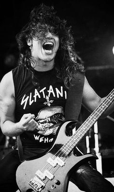 """Young TOM ARAYA, founder, singer, songwriter and the bass player of the legendary thrash metal band SLAYER. Playing live with a SLAYTANIC t-shirt """"The World's Online Heavy Metal T-Shirt Store"""". Heavy Metal Rock, Heavy Metal Bands, Metal Fan, Hard Rock, Tom Araya, Metallica, Kerry King, Rock Poster, Metal T Shirts"""