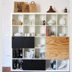 Customizing your shelves with slides and doors will help you get the most bang for your Ikea bucks.