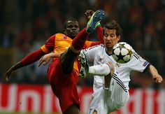Galatasaray's Emmanuel Eboue, left, fights for the ball with Real Madrid's Fabio Coentrao during a Champions League quarterfinal soccer match in Istanbul, Turkey, Tuesday, April 9, 2013. (AP Photo/Thanassis Stavrakis)