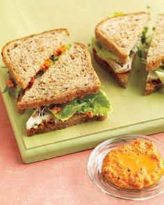 Turkey Sandwich - Whole Living Eat Well  2 slices whole-grain bread, lightly toasted if desired  2 tablespoons Romesco Sauce  3 ounces roasted turkey breast, sliced  2 small leaves romaine lettuce  Small handful arugula leaves  Small handful broccoli sprouts