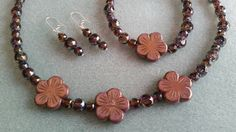 Check out this item in my Etsy shop https://www.etsy.com/listing/469949770/bronze-flower-czech-glass-beaded-jewelry