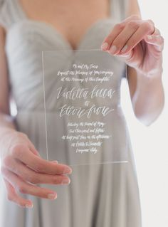 Clear glass invitation with beautiful sweeping calligraphy