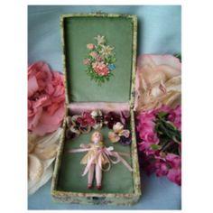 miniature doll in box