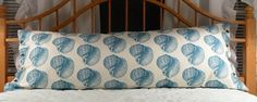 """Vibrant turquoise """"Neptune"""", Conch Shell body pillow cover in 100% cotton designed by ThomasPaul for Duralee fabrics. $32.00, via Etsy."""