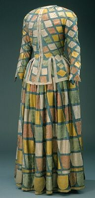 DESCRIPTION:  Harlequin costume, probably worn by Ulrika Eleonora the Elder of Sweden at the royal court masquerades , 1656-1693.    Materials appear to be silk appliquéd over wool or possibly silk (the bottom dress layer looks to be flat (low sheen) and woven.  Could also be silk broadcloth.  Judging from the VERY unfinished collar and cuffs, I would assume that fancy ruffs would have been part of the costume.  What a unique bit if history!!