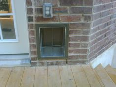 A medium sized PlexiDor dog door installed into a brick home!
