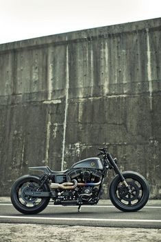 The 2014 Bike EXIF custom motorcycle awards are out, and here's one of the Top 10: 'Urban Cavalry' by Rough Crafts. There's a sinister, sci-fi look to this Harley-Davidson Dyna. It's based on a 2014-spec Dyna Street Bob, but it's running Kawasaki sportbike forks and a custom alu swing arm. Power gets a boost from S&S 'Super G' carburetion and a titanium exhaust worthy of a Formula 1 car. Click through to see the other award winners. #harleydavidsonstreet750exhaust