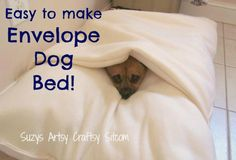 Sew a simple envelope dog bed for the snugglers! An easy DIY dog bed that uses only three yards of fleece. Diy Pour Chien, How To Make An Envelope, Diy Envelope, Diy Dog Bed, Dog Crafts, Animal Projects, Diy Stuffed Animals, Pet Beds, Doggie Beds