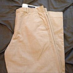 Banana Republic Men's Modern Fit Trousers Men's Banana Republic Modern Fit trousers. Sand colored. 32/30. One small stain as pictured- should come out with dry cleaning. Banana Republic Pants Trousers