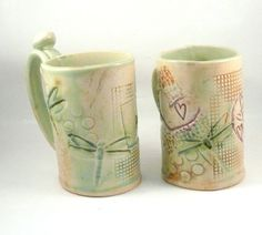 What a wonderful gift for a favorite couple! Handmade personalized his and hers ceramic mugs with HIS impressed into the clay on one and HERS on the other! Great as a birthday gift, engagement, wedding, anniversary, any occasion.  Their coffee cups will never be mixed up with anyone else's at home or the office.They work great as a wonderful beer stein or tankard, too.up to six weeks to complete. Yours won't be exactly like those above, but very close and just as awesome. (And I have several…
