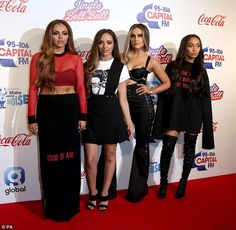 Dressed to impress: Perrie Edwards stole the show in a slinky satin bralet paired with hig...