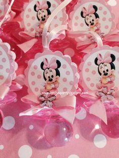"""Minnie Mouse Baby Shower Pacifier Necklace.  This beautiful Minnie Mouse pacifier necklace are a fancy way to present favors for your Baby Shower. Use these cute baby shower pacifiers as baby shower favors and a """"Don't Say Baby"""" game. The necklace is made of 1/8 satin ribbon. Each pacifier measures 2 1/2"""" long. Have two-sided minnie mouse and bows."""