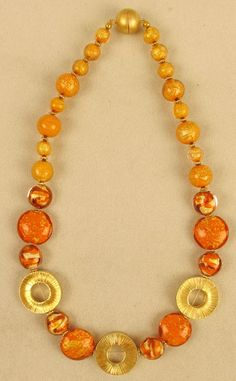 """VENETIAN ORANGE CRACKED GOLD BEADS with Circle Accents Don't shy away from bright colors. This necklace will sparkle when you wear it will all your neutral colors. You won't believe how the cracked gold makes these sparkle. The large gold filled circles makes the whole look pop. Length: 20"""""""
