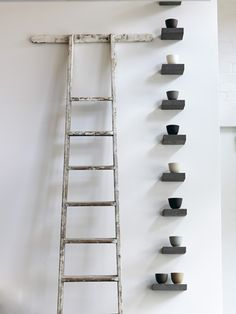 my love for asymmetry, ladders and pottery collections says 'yay!'