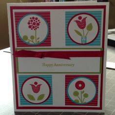 """Card Stock: Brights DSP, Real Red, Whisper White, Tempting Turquoise, Lucky Limeade / Ink: Real Red, Tempting Turquoise, Lucky Limeade / Cool Tools: 1 1/4"""" Circle Punch, 1 3/8"""" Circle Punch / Stamp: Teeny Tiny Wishes, Bright Blossoms / Embellishments: Real Red Grosgrain Ribbon"""