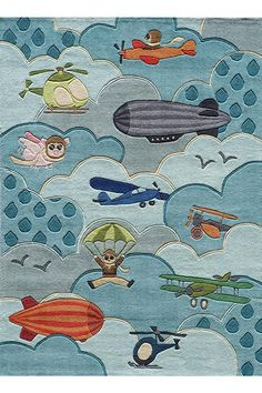 This striking sky blue Pilot area rug boasts planes, helicopters, blimps and even a flying pig! So cute for a kid's room. Check out the other adorable kid's rugs when you click through to Home Decorators Collection.