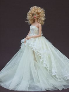 Wedding Gown for Silkstone Barbie - I would put a hoop skirt or crinoline underneath. Skirt is made of tulle with sheer/lacey overlay at back.