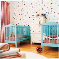 Two cribs for twins or one crib and a toddler bed for those close in age. Love how colorful and cheerful it is.