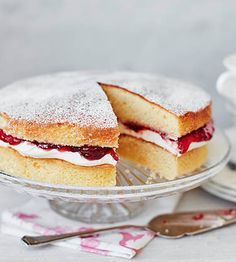 This quintessentially British bake is simplicity at its best: sweet strawberry jam and pillowy soft cream, sandwiched between two light sponge cakes and a dusting of icing sugar. | Tesco