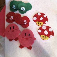 Kirby, Mario & Luigi hats, and mushrooms I'm going to make into magnet favors for Bro's birthday party. Going to make Princess' crowns too!  All out of felt.