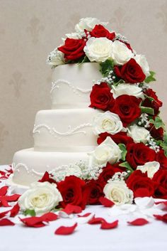 I love how all the roses are spilling over this cake. Beautiful!