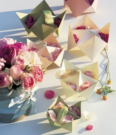 origami fortune tellers used as rice & flower petal bowls! awesome! i could use these as a snack bar at a party <:)