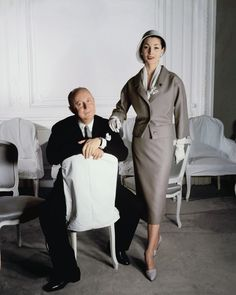 Henry Clarke photographed Christian Dior and Renèe, one of his models in a pale green suit from the Spring-Summer collection of 1957.