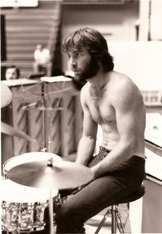 Dennis Wilson, rehearses at the University of Oklahoma in Norman, Okla., sans T-shirt on May 2, 1969, likely sporting his first beard