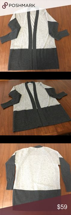Vince Camuto 100% Cashmere Sweater cardigan A lovely VINCE Camuto 💯 Cashmere open front Sweater / Cardigan. This is a beautiful two tone grey color and oh so soft. Marked XS, please refer to photos for approx measurements. Overall good used condition with light wear, the pockets are still sewn shut. There is a little bit of piling / balling here and there and the tag has marks on it, this is usually to prevent returns. Please take a look at all the photos and use them as part of the…