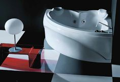 Treesse's stylish large corner bathtub with internal twin seat / Dafne Collection