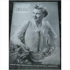 "1940's Sirdar knitting pattern 1069 ladies bedjacket bust 34"". Eyelet pattern, ribbon bow neck tie."