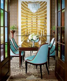 The visual effect of that print is stunning.  The aqua chairs and chandy aren't too bad either!