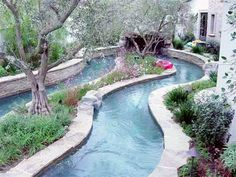 Lazy river in the back yard! Cool idea!