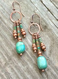 Hammered copper hoop with genuine Campo Frio turquoise, aged Czech glass beads and antiqued copper accents. Approx 2 in length and light weight.