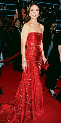 Catherine Zeta Jones in Versace. 1999. Simply my all time favorite designed Dress on a Woman.  It doesn't hurt that I think She's gorgeous too...  But that dress, WOW!
