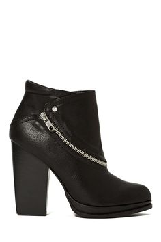 Shoe Cult Zip Up Bootie, $88 at Nasty Gal. An asymmetric zipper lends toughness to the classic stacked-heel style and would look good with nearly everything in your closet.