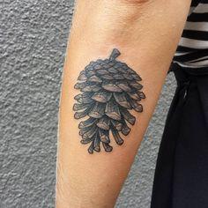 Black Ink Pine Cone Tattoo On Left Arm