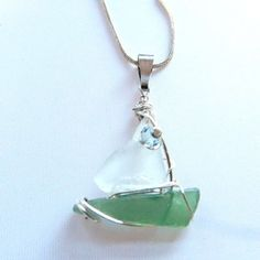 Sailboat with sea glass and silver on a silver plated serpentine chain, sterling silver wire wrap, Swarovski crystal.