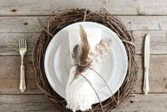 Feathers are a versatile accessory that are great for fall decorating. Simply tie a leather lace around the napkin and inserted various feathers. This would be great on a Thanksgiving table