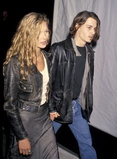It's almost cool enough to wear leather jackets. Kate Moss and Johnny Depp in the timeless wardrobe staple.
